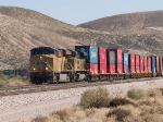 UP 7704 leads a WB doublestack at 12:48pm