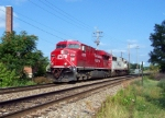CP 8795 and Soo 6036 are running light eastbound