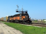 Two ex-Milwaukee Road units lead an auto train towards Chicago