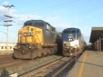 CSX 7723 and Amtrak 108 side by side