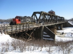 CN 7218 on the coolest swing bridge in the world. Note the traffic going across the bridge at the same time