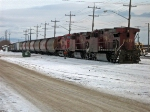 North/east bound grain train putting its pusher on the trail end of the train