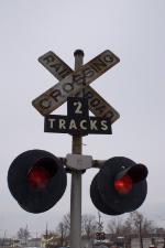 "Notice the cast ""Railroad Crossing"" crossbuck."