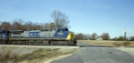 CSX 7369 Slips past old farm place