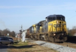 CSX 7718 hits a crossing
