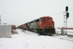 CN 5561 departs the yard while another westbound waits