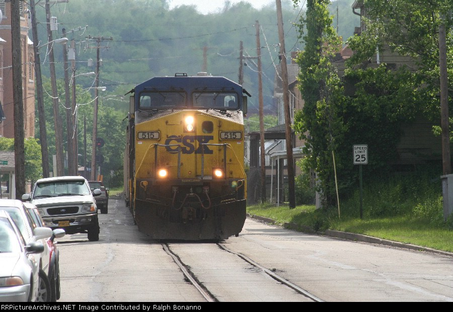 A northbound CSX loaded coal train starts his way up Main St on ex MGA tracks