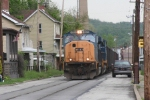 Southbound empty CSX hopper gently rolls down Main St, southbound