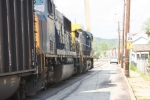 Northbound loaded coal train begins its way up main street