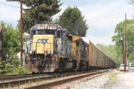 Eastbound auto racks with classic power rolls through town on a spring sunday