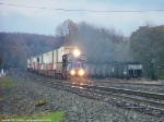 Eastbound intermodal passing loaded coal hoppers