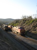 SB freight Q595 passing a welded rail train
