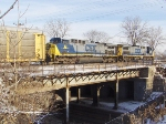 CSX 62 and 250 lead an autorack train over Water Street