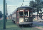 Streetcar 963 waits for a slot at Carrollton & Claiborne