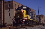 The 2003 Conrail Browns Yard Santa Train passing the old Helmetta Tobacco & Snuff Factory