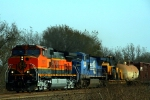 BNSF C44-9W 1075 and NS C40-8W 8445 lead a westbound merchandise train