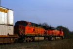 BNSF C44-9W 5302 trails ES44DC 7554 on an eastbound stack train.