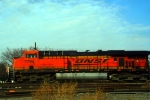 "BNSF ES44DC 7794 zooms west with a hot ""brown"" train."
