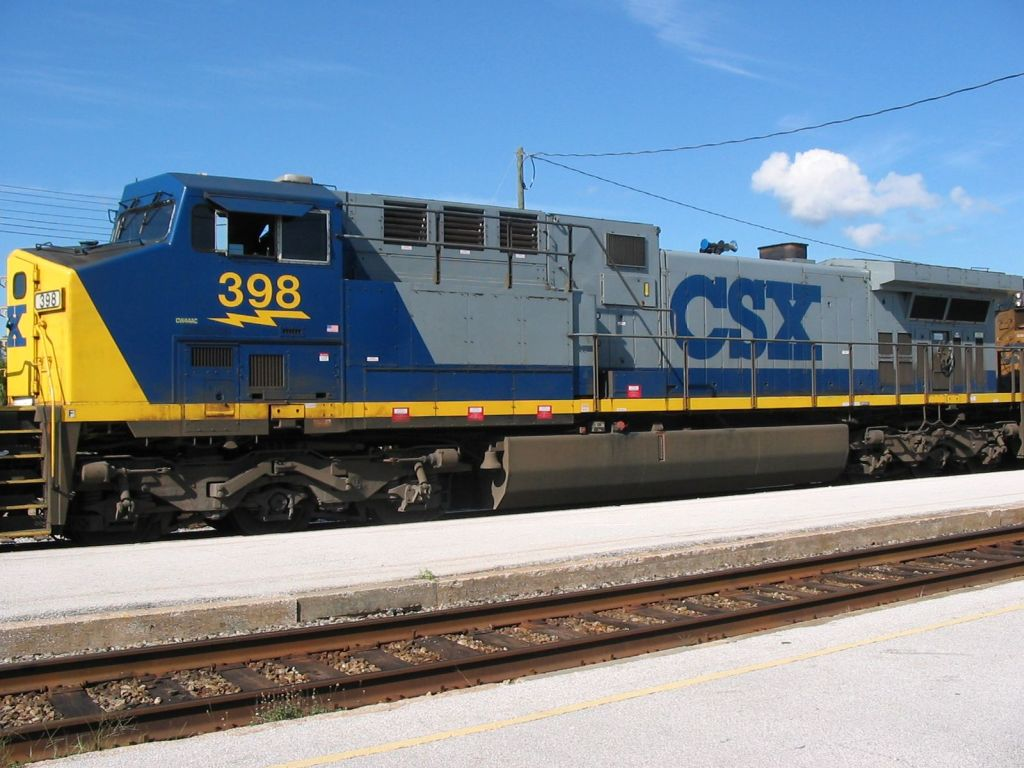 Oucx coal train sits at the SAnford depot waiting on a crew and a singnal