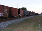 Some Cardboard hanging and dragging out of a boxcar