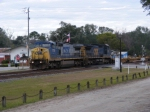 CSX 7731 leads an empty baretable train