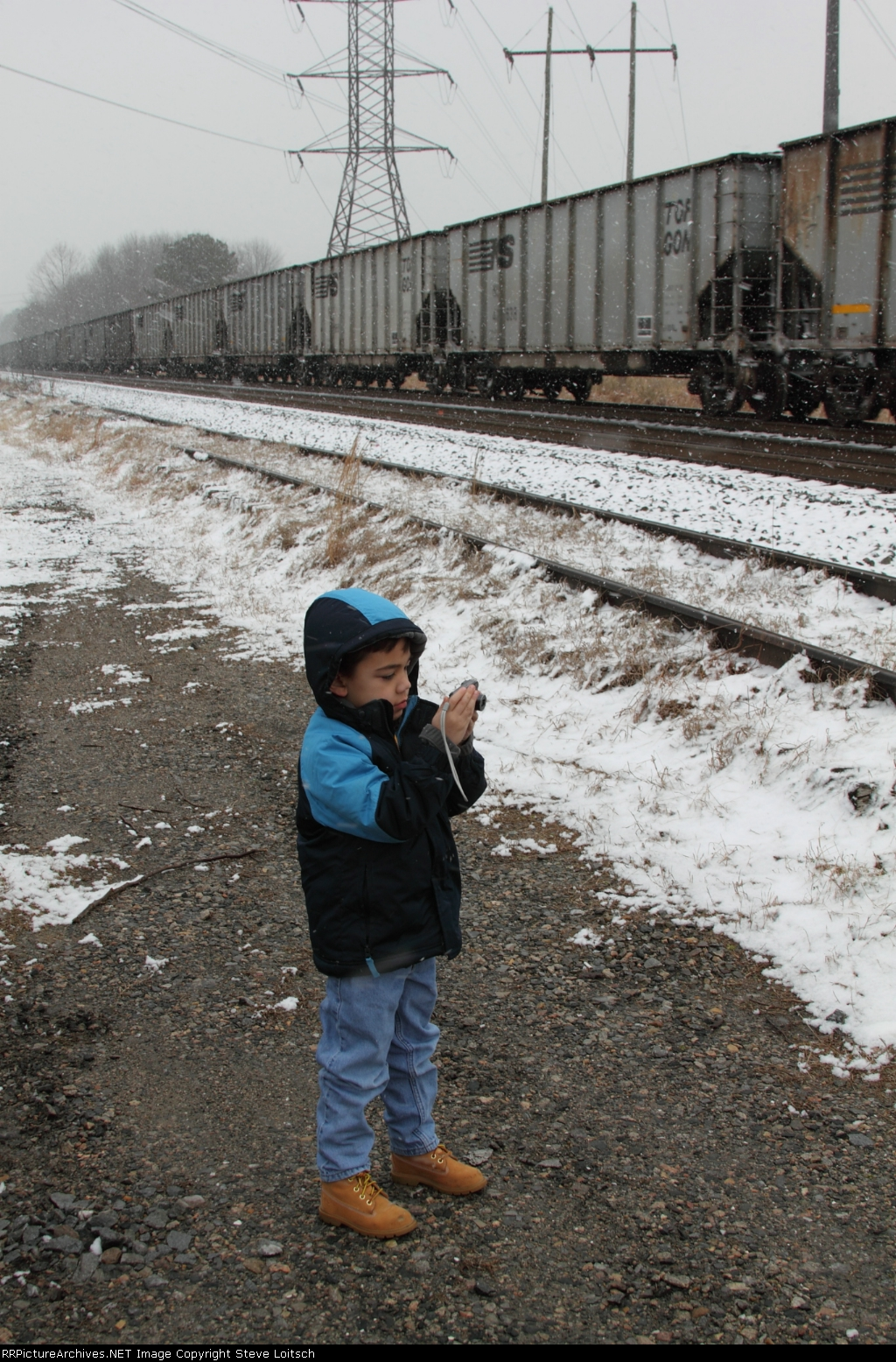 My railfan partner trying out his new camera!!!