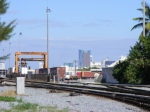 Looking Northeast toward the South gate to FEC's intermodal terminal. Broward General Medical Center and the downtown skyline in the distance