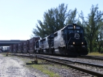 FEC Train 218  powered by 411, 410 and 417 with about a mile of intermodal sitting idle and  waiting for its crew to arrive