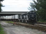 FEC Train 222 rolls through the yard