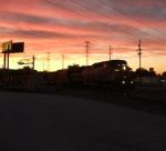 CSX 7706 leads Q370 as the sun sets