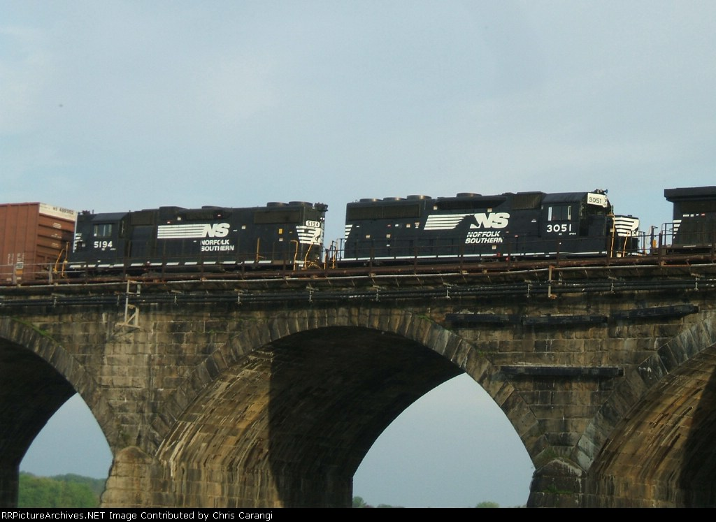 NS 3051 & 5194 are in the consist of a change crew heading for Enola