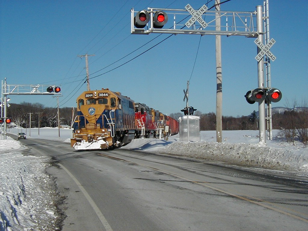 NECR 3844 3840 & 3857 with southbound freight in crossing 1/3/08
