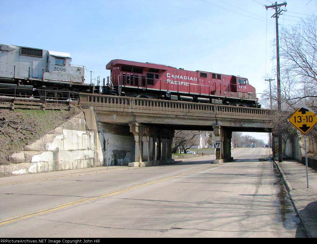 080415008 Eastbound CP freight on BNSF St. Paul Sub. crosses over 18th Ave NE
