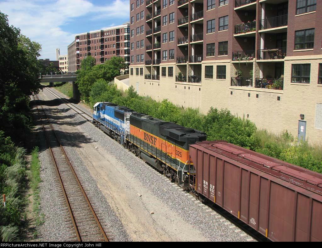 080805004 Westbound BNSF freight passes 1st Street North on Wayzata Sub.