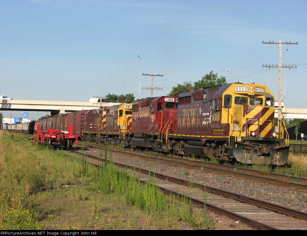 080814032 Eastbound TCWR grain train in siding has just met westbound UP unit covered hopper train