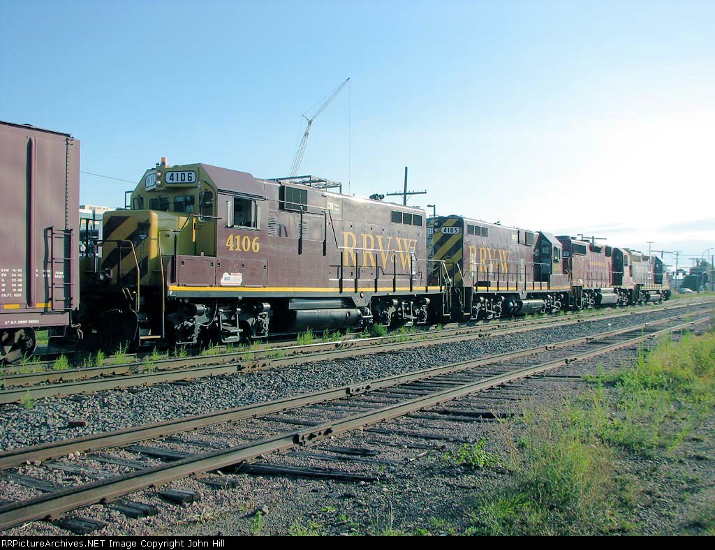 080814034 Eastbound TCWR grain train in siding has just met westbound UP unit covered hopper train