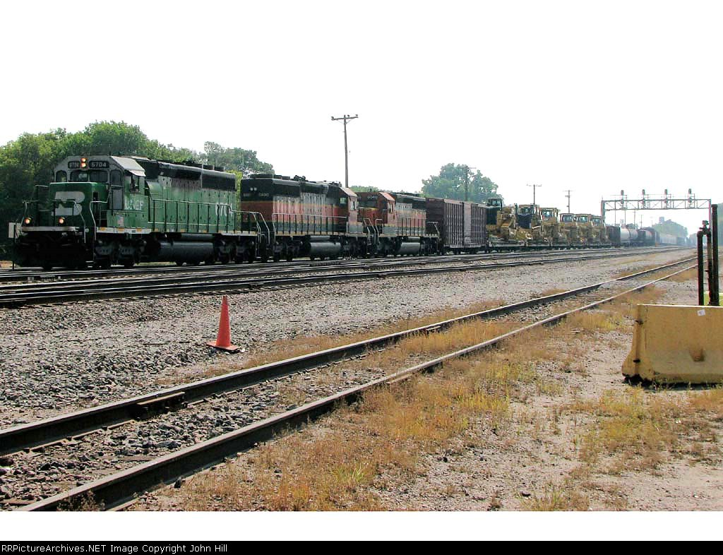 "080901001 Westbound BNSF freight with ""High-wides"" at Northtown CTC University"