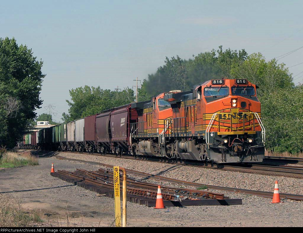 080918048 Eastbound BNSF freight crosses Foley Blvd. on Staples Sub.