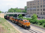 080719018 Westbound BNSF freight on Wayzata Sub passes new Stadium construction site