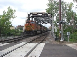 080914004 Eastbound BNSF crossing Nicollet Island on the Wayzata Sub.