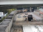 081012032 Westbound BNSF (DEEX) coal empties pass Northstar Stadium depot construction site at 5th Street bridge