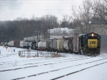 CSX 8550 leads Q335 into the yard during a break in the snow