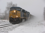 Brand new CSX GEVO's lead N924 west through the snow storm