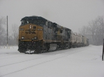 CSX 5448 Leads Q335 into the yard as the snow continues to fall