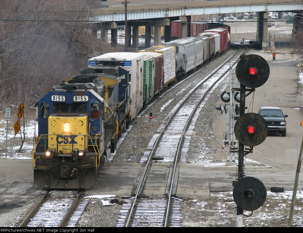 Q326-16 rolls out of the Sunnyside interlocking as the Pleasant Street signals stand guard