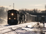 X500-01 heads east under the winter evening sun with a pair of BNSF units on the point and a recrew aboard