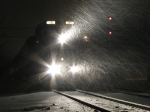 506 lights up the swirling snow as P370 waits for the signal to back towards the station from Pleasant Street