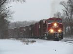 8775 works hard as it leads X500-19 up the grade eastward out of town