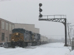 Q335-26 rolls under the Godfrey Ave signal bridge in the falling snow