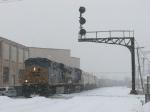 Q335-26 rolls under the Godfrey Ave signal bridge in the falling snow